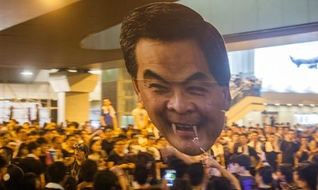 Occupy Central protesters hold up a giant head of Leung Chun-ying.