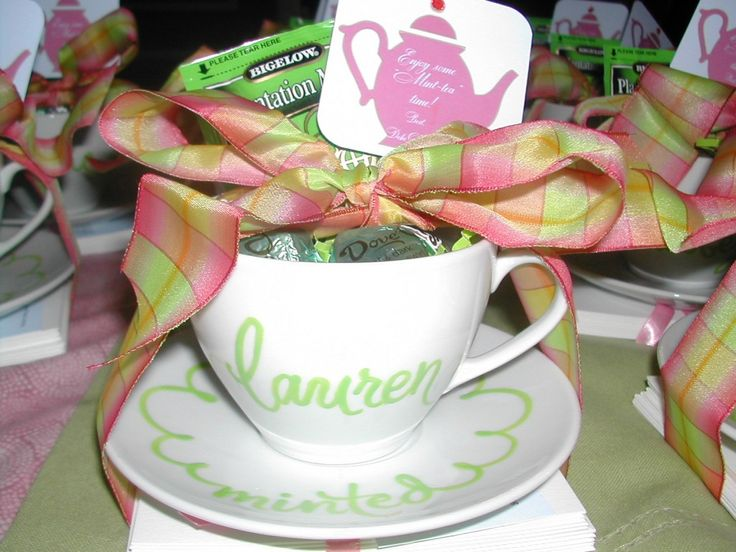 Tea Cup Favor:  I don't really care for the personalization but I like the idea of adding in a few Dove candies with a tea bag and cute tea tag and tying it up with ribbon like this.