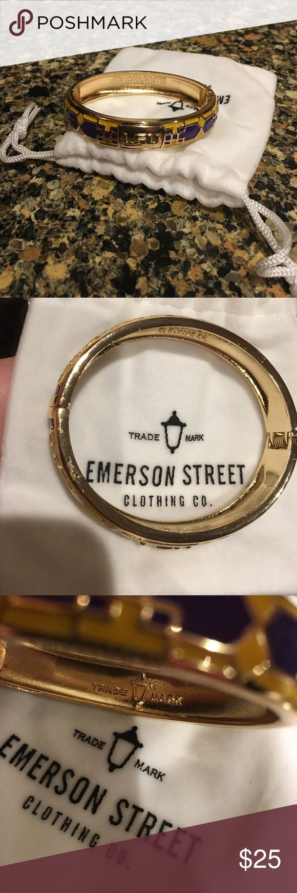 LSU Emerson Street Mosaic Bangle Cheer on your LSU Tigers on game day with this with Mosaic bangle! You'll have the look of a tried and true fan! Only worn once with minor scuff on top not noticeable when  on. Has a spring-loaded hinge so when opened  will want to close. Comes with white pouch. Emerson Street Jewelry Bracelets