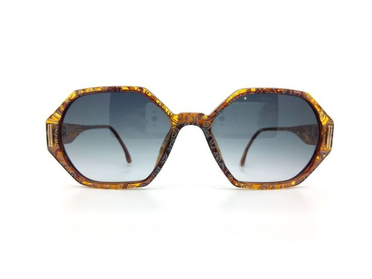 Christian Dior   1980s  Made in Germany  Mod. 2597 Col.40  Size : 55-17 135  Christian Dior elegance in a dark and light brown acetate with silver  'swirl' patterns, these hexagonal frames really are special. High quality  acetate from Optyl means these frames are lighweight and durable.
