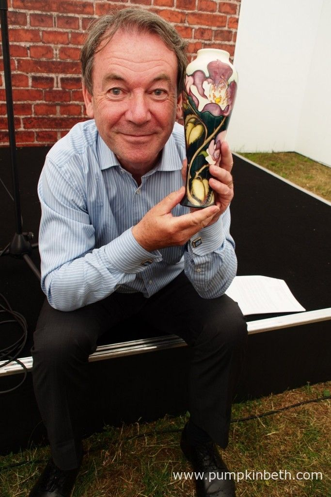 Director of Moorcroft Pottery, Ceramic Antique Expert, Eric Knowles, pictured with the new Moorcroft Vase, which was designed by Kerry Goodwin and is decorated with images of Rosa 'Moorcroft', which was grown by Style Roses from Holbeach in Lincolnshire, at the RHS Hampton Court Palace Flower Show 2015.  Only 50 of these special vases were produced.