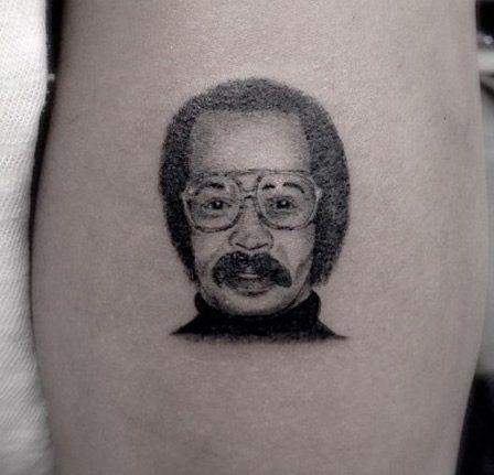 Drake Gets His Father's Mugshot Tattooed on His Arm - http://www.popstartats.com/drake-tattoos/arm-fathers-mugshot/