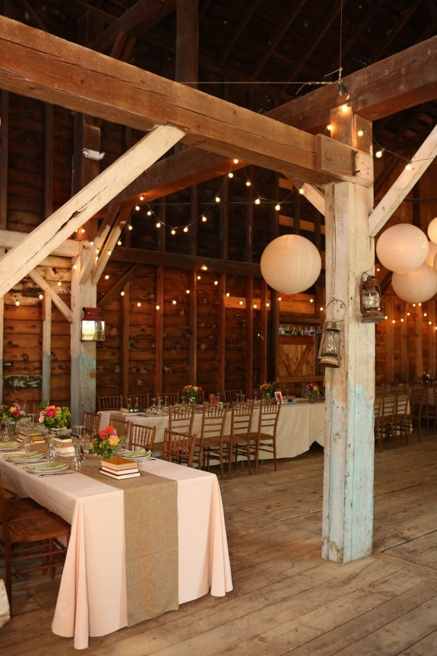 Wedding Barn Country Wedding! Lantern and string lights....also like the table decore