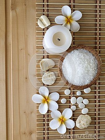 Salt,shells and tiare flowers on the wooden background
