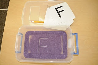 Sand Writing - The children use their fingers or a pencil eraser to practice writing letters or sight words in sand.