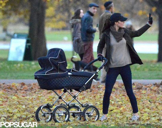 A rare look at Princess Kate out and about in Kensington Gardens with Prince George in his Silver Cross pram.  5/12/13