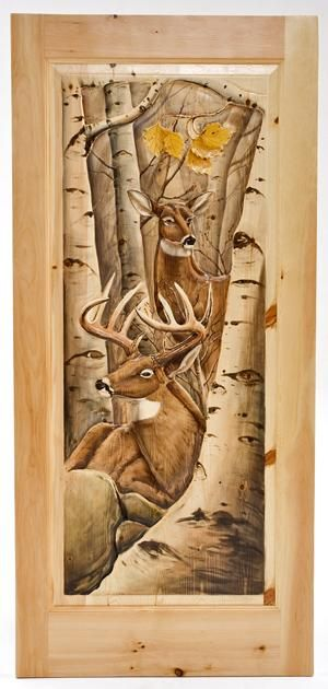 Woodland Creek specializes in unique hand carved doors.  Each carved door can be made with the scene of your choice. These are NOT done with CNC routers.  They are hand carved and then hand painted the old fashioned way.  We have one of the finest carvers in the country working for us.  The doors looks