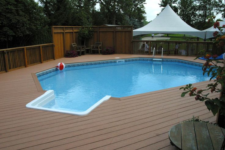 An onground pool deck built by Hickory Dickory Decks using low maintenance Xtendex composite decking.