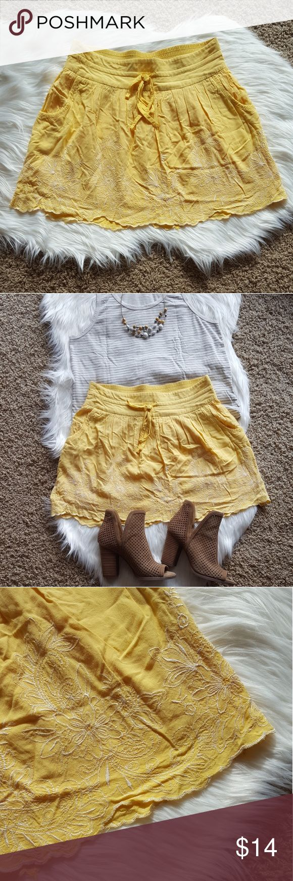 """Charlotte Russe Yellow Embroider Skirt Beautiful for spring! Yellow miniskirt with white floral embroider details and pockets! Also used to be a favorite of mine, but I don't wear skirts much anymore! Skirt is lined and also has scalloped edging...a lot of details going on here! In great condition with no rips or stains.   Length: 14.5"""" front, 15.5"""" back Width at waistband: 14.5""""and stretchy Charlotte Russe Skirts Mini"""