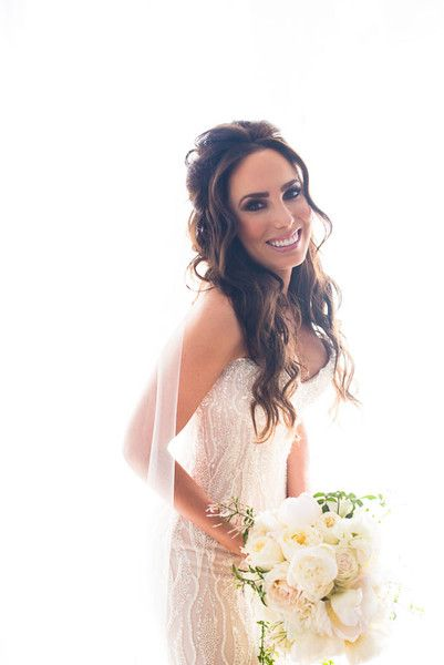 Gorgeous, gorgeous curls! We're so in love with this bride's half-up, half-down wedding hairstyle, especially those face-framing pieces. {Photo courtesy of Callawaygable}