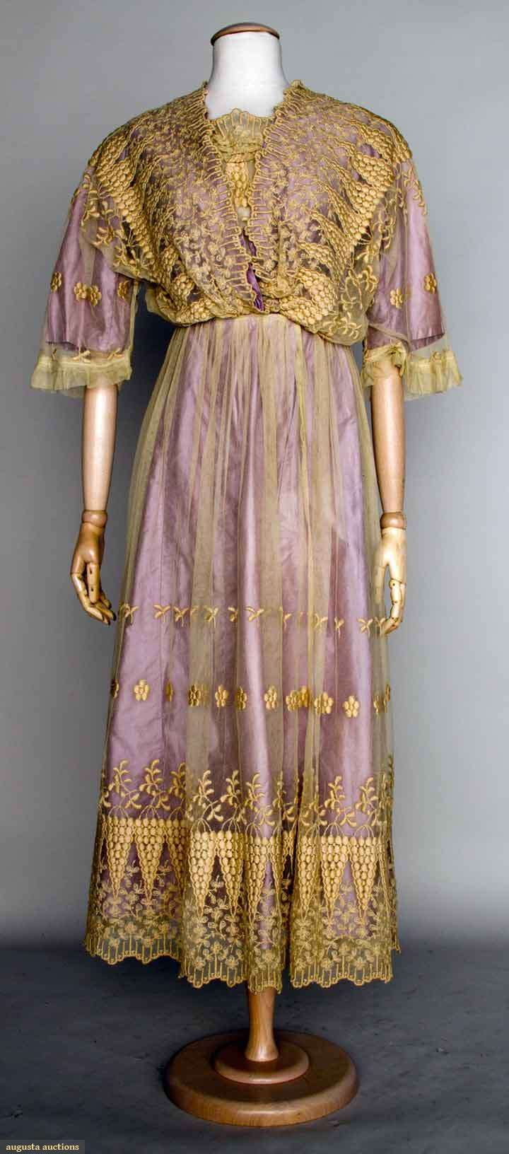 1914-1918 embroidered tea gown: Cream cotton net, floral embroidery, and lilac underdress