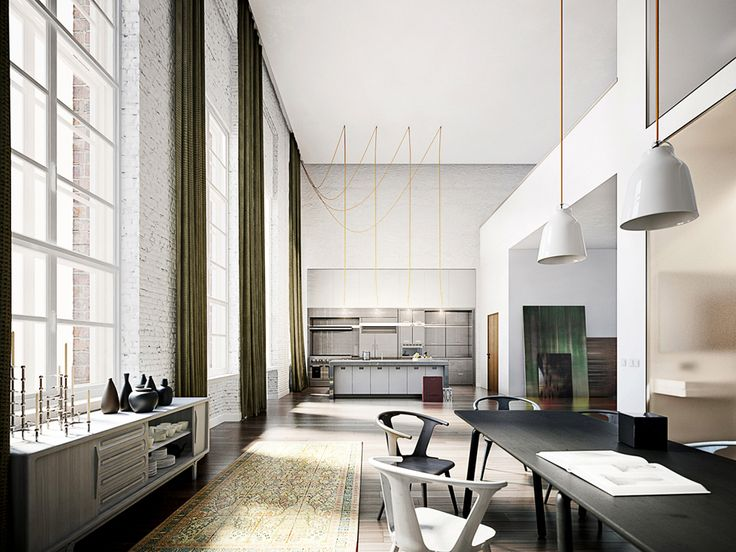 The centerpiece of this extraordinary loft is the spacious living-dining area with open-plan kitchen.