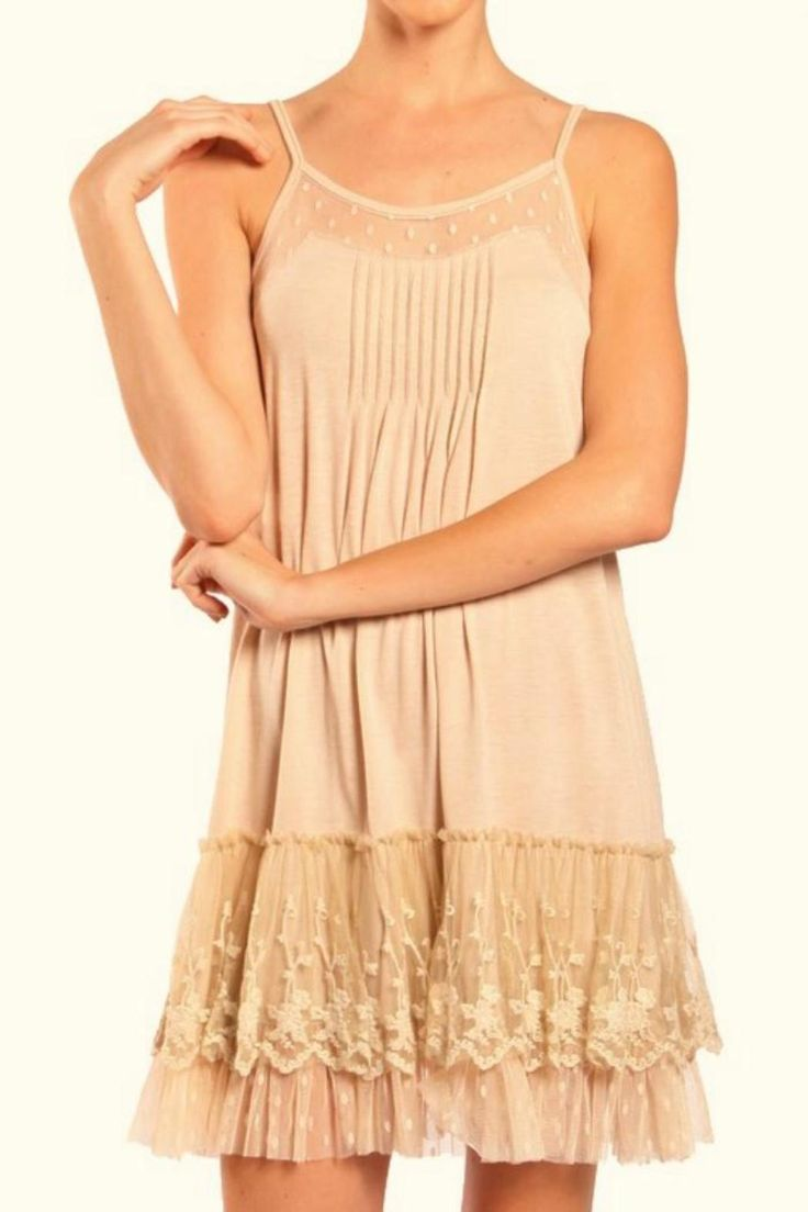 Blush pink lace trimmed slip dress with adjustable straps. Wear this dress with a flowing cardigan or belt it for a fitted look. Blushing Slip Dress by Ryu. Clothing - Dresses Houston, Texas