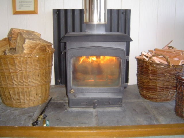 Woodburning stove at Kirkland Lodge