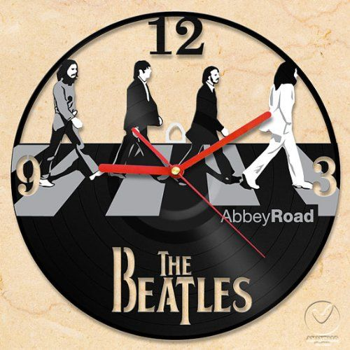 """Handmade The Beatles Abbey Road Vinyl Wall Clock The clock is handcrafted from used vinyl. size of 12""""or 30 cm.. non-ticking sound, absolutely silent and smooth operation. Each item has been carefully designed, cut out and painted in modern style.. it requires just 1 AA battery.."""