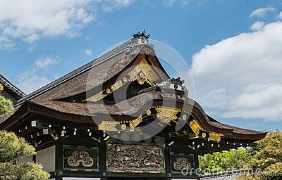 Ornamented roofs of Nijo Castle in Kyoto. Nijo Castle also known as Second Palace, Ninomaru Palace, a flatland castle founded 1679, Kyoto. Japan.