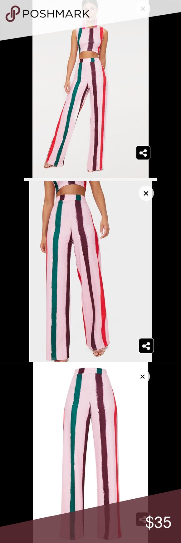 "Light Pink Multi Thick Stripe Wide Leg Trousers Featuring a light pink stretch material with multicoloured stripes and a wide leg fit, these trousers are sure to elevate any look. Match them with the co-ord crop top and finish off the look with some strappy heels. Length approx 89cm/35"" (Based on a sample size UK 8) Model wears size UK 8/ EU 36/ AUS 8/ US 4 Model Height - 5ft 6"" Pants"