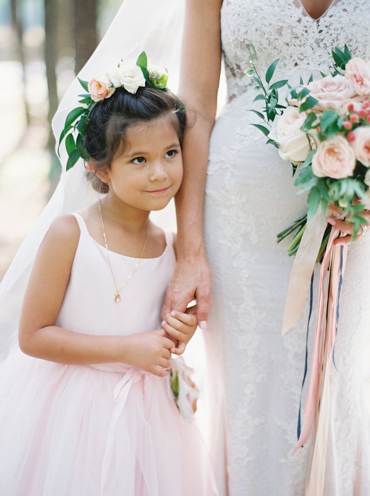 A flower girl by your side: Wedding Dress: Rivini - http://www.rivini.com/ Ceremony Location: West Kootenai Community Church - http://www.stylemepretty.com/portfolio/west-kootenai-community-church Bridesmaids' Dresses: BHLDN - http://www.bhld.com   Read More on SMP: http://www.stylemepretty.com/2017/02/27/rustic-montana-whitefish-lake-wedding/