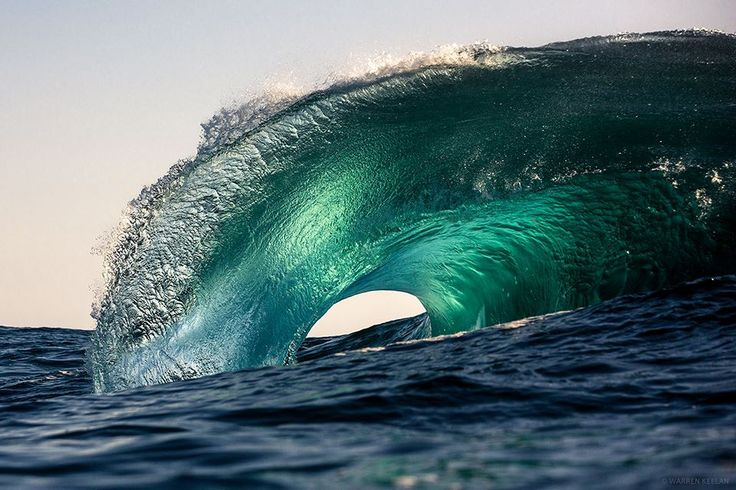 Australian photographerWarren Keelan (previously) captures crashing waves from beside, and sometimes within their swell. Clad in a wetsuit he takes to the South Coast of New South Wales, Australia to photograph the dazzling curvature of waves right as they break. Keelan sells prints of both the wav