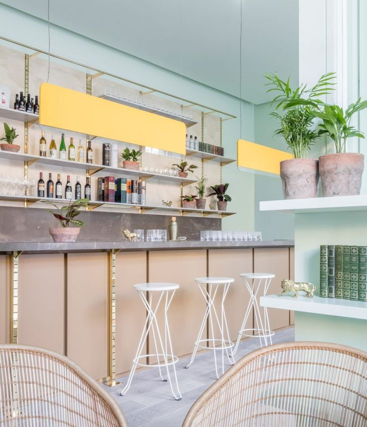 Pastel-coloured walls, wicker furniture and an abundance of planting feature inside this Edinburgh hotel