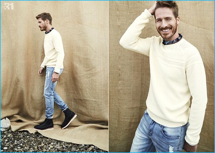 All smiles, Ryan Burns rocks a jacquard sweater, ultra-faded distressed denim jeans, and a paisley bandana from LE 31.