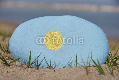 Flag of Palau on a stone over the sand