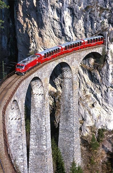 Red Train Bernina between Italy and Switzerland Bernina Express crossing the Alps - Begins in Chur, Switzerland and ends in Tirano, across the border in northern Italy.
