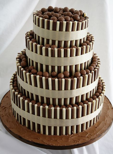 Four tier Chocolate Wedding Cake, decorated with milk and white chocolate cigarellos and Maltesers - wow!