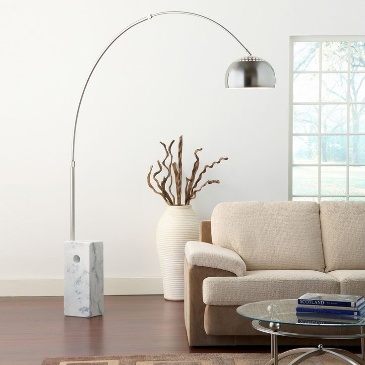 The god Apollo brought in the sun on his chariot. You can do the same with this gracefully arched metal lamp in your home. A large marble block provides a stable foundation for this modern light piece.