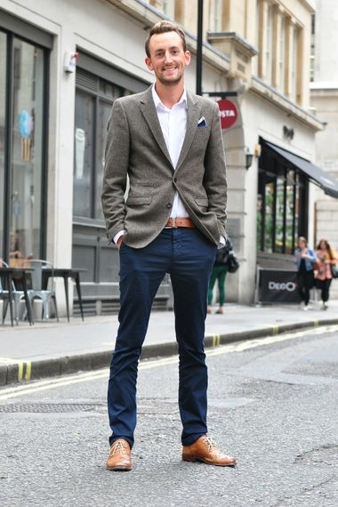 Dark blue chinos and light brown leather shoes.