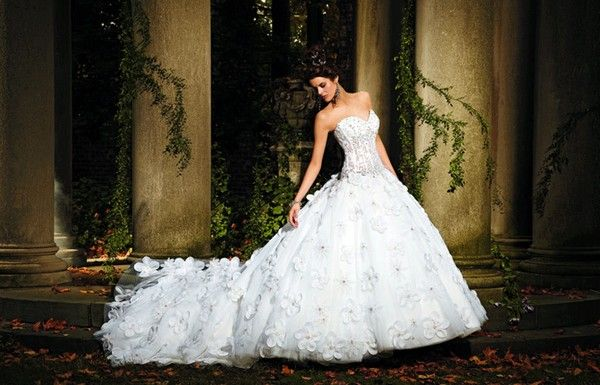 Wedding dress by Eve of Milady. Reminds me of pnina tornai dresses, except probably cheaper. : )