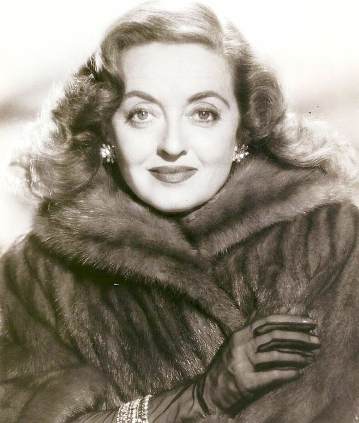 "Bette Davis/....from All About Eve, for which comes the famous quote, ""Fasten your seat belts, kiddies. It's going to be a bumpy ride."" a la Margot Channing"