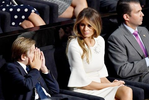 Barron Trump, Melania Trump and Donald Trump Jr. listen to Republican presidential candidate Donald Trump deliver his speech on the fourth day of the Republican National Convention on July 21, 2016 at the Quicken Loans Arena in Cleveland, Ohio.