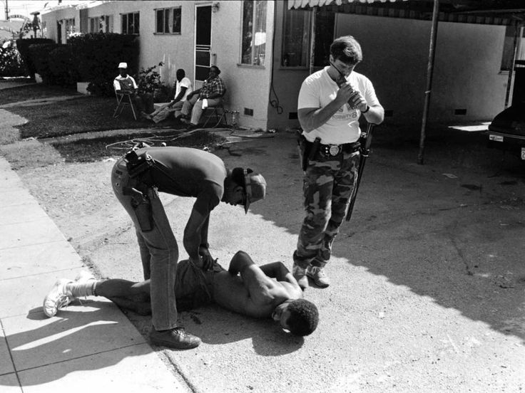 The crack-cocaine epidemic was especially bad during Valentine's time on the beat. As such, officers were often trying to bust people suspected of selling the drug. Below, Officers Taylor and Blanchard arrest a man suspected of selling cocaine after chasing him on foot.