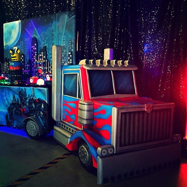 Instagram media by designplanplay - Transformers Party the uber cool truck dessert table and backdrop by @bambinisoiree LED up lights @maxonevents Desserts by @opopsbyangie Cake by @cakesbyrc Venue @laserlandadventure #designplanplay #transformers #autobots #rollout #OptimusPrime