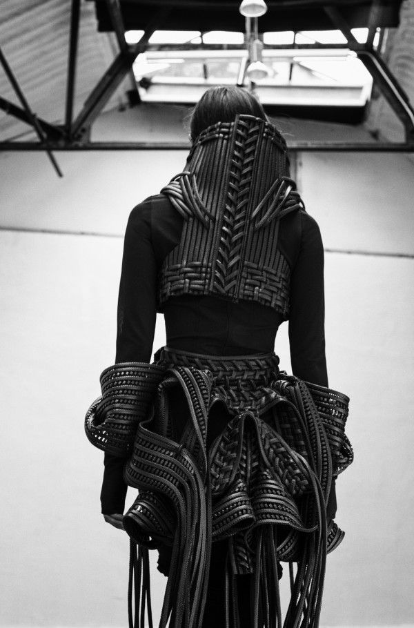 Armour Fashion - sculptural silhouette with layers of woven leather, fringe & 3D twisted shapes; fashion as art // Sarah Ryan