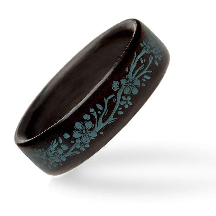 This bentwood ring combines expert craftsmanship with a beautiful laser engraved floral vine. The rich ebony construction offers a dark backdrop for the stunning Azurite stone inlay. This ring is sure to please and, better yet, it is sized to fit and comes with our Care for Life Guarantee.