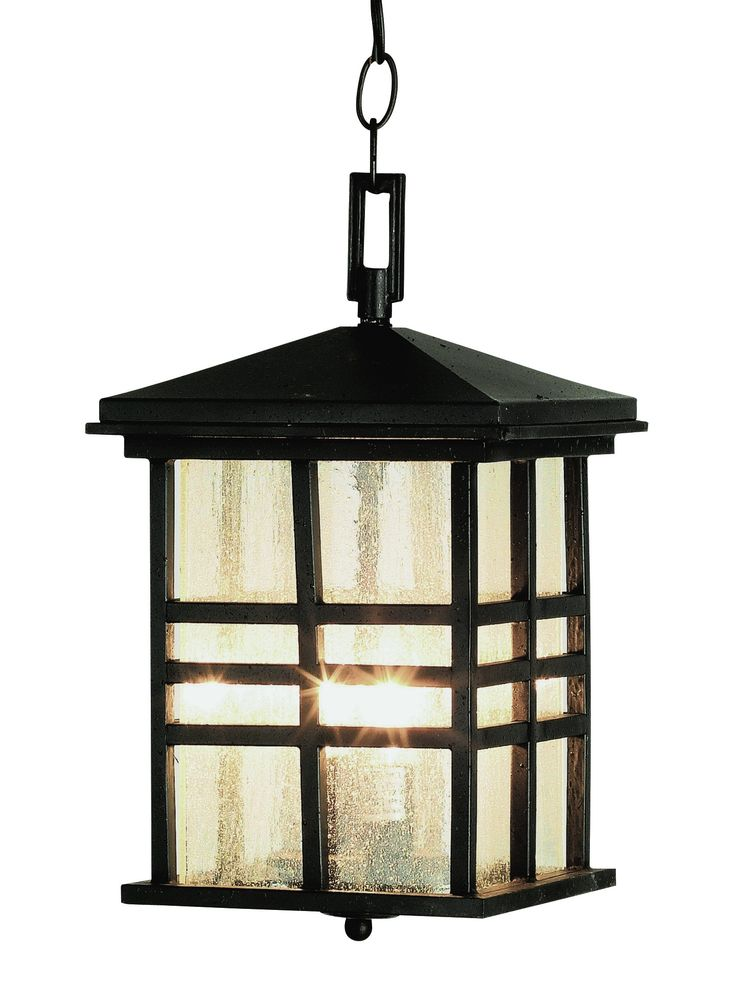Rustic mission style outdoor hanging light perfect for rustic cabin décor. Clear seeded glass in three bar frame. Finish: Black Height: 15.5'' Width: 8.5'' Depth: 12 cross-wise'' Bulb: 2-Candelabra -