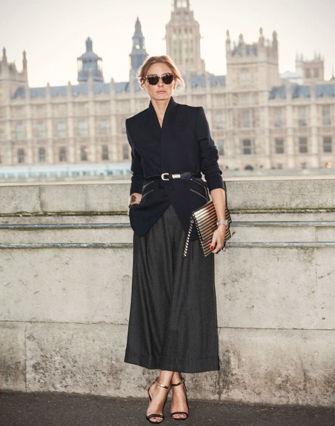 Olivia in a Reiss jacket and belt paired with Michael Kors wide-leg cropped pants, Wunderkind sunglasses, a Witchery clutch and Shultz heels.