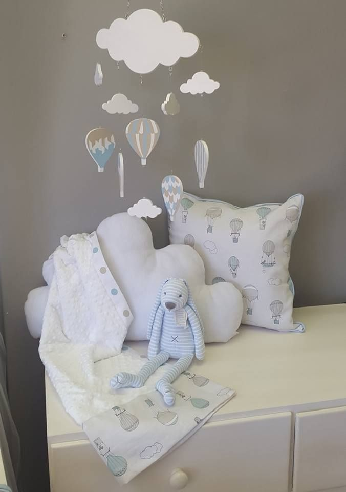 Reversible scatter cushion fashioning our Up and Away, Blue fabric; which is printed especially, and exclusively, for Studio Collection. Our Wooden Mobile carefully designed to match our theme, and an adorable blanket and soft toy to wrap it all up.