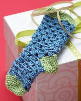 Lighten up your holiday decor with these sweet little stockings. Shown in Bernat Handicrafter Crochet Thread.