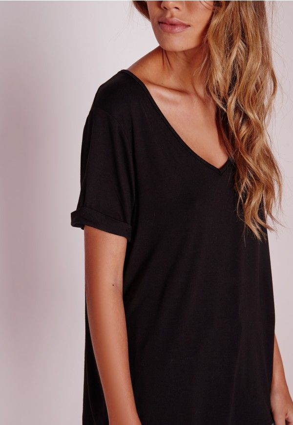 """Good things come in small packages. Shop our Missguided Petite range, for babes 5""""3 and under.   Update your wardrobe staples with this chic petite V neck boyfriend t-shirt in on point black. Its loose fit, soft jersey fabric and V neck..."""