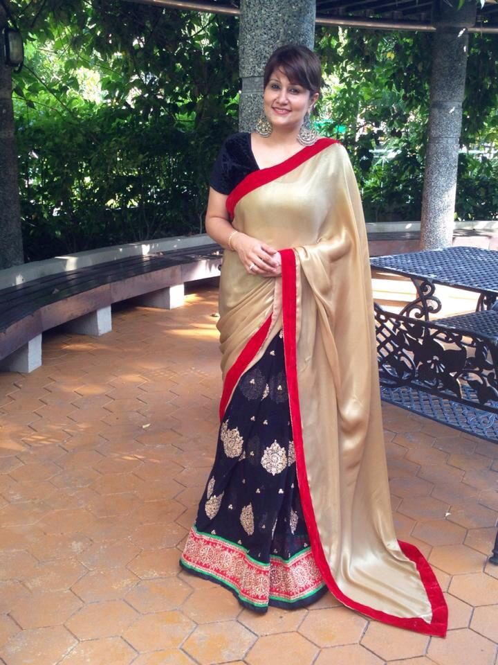 Gold & black georgette Saree with gold embroidery on the pleats.