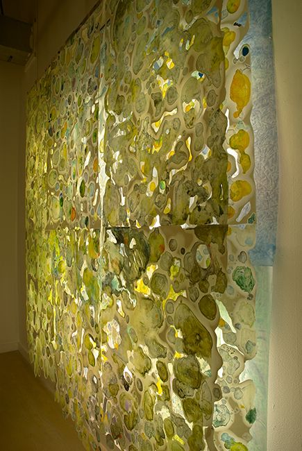 """Paula Roland """"Disappear"""" 2009; 78"""" x 80"""". Installation side view of 12 layered encaustic monotypes and fluorescent lights. Photo by Bernard Handzel"""