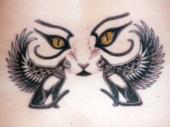 In ancient Egyptian hieroglyphic art, eyes represented the watchful, protective gaze of a god or goddess. In this tattoo, the eyes are those of the cat goddess, Bast. The cats to either side of the Egyptian cat eyes are designs taken from hieroglyphics found in Egyptian tombs. Cats with wings symbolize spiritual enlightenment or a link with the spiritual world.