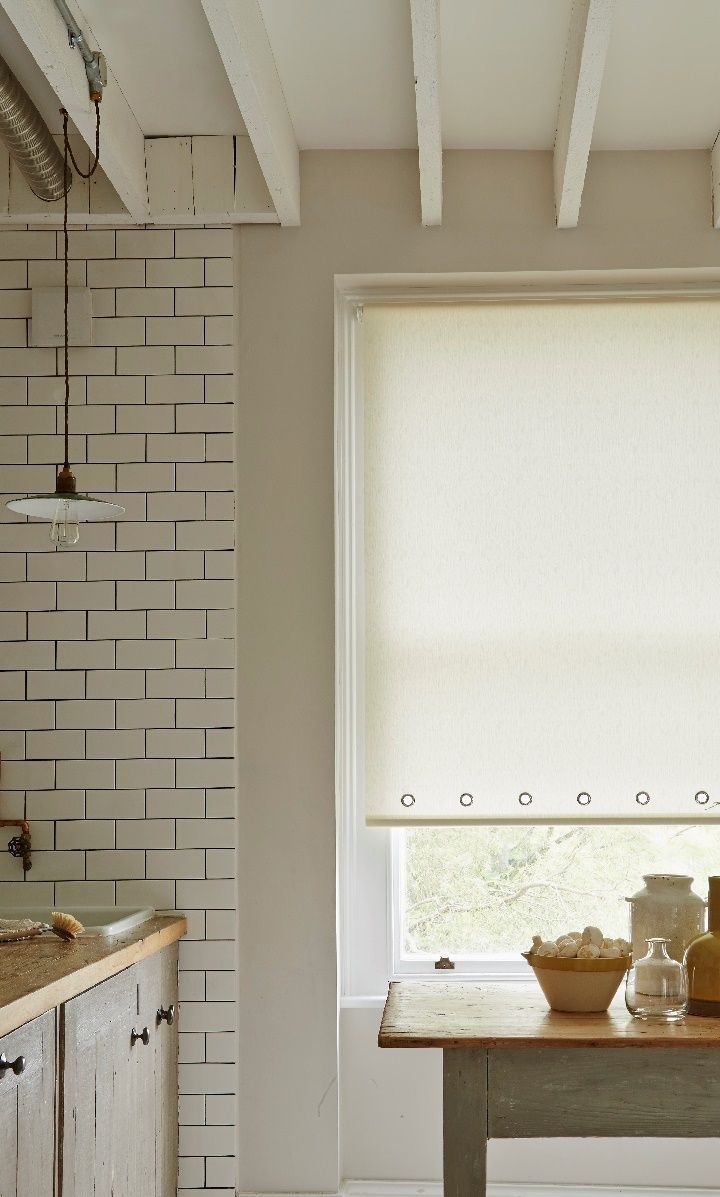 Use textures in the same colour to create impact within a room. Add accessories in dark colours and wood to complete the look, made to measure cream Roller blinds with eyelets create an interesting look. www.hillarys.co.uk/