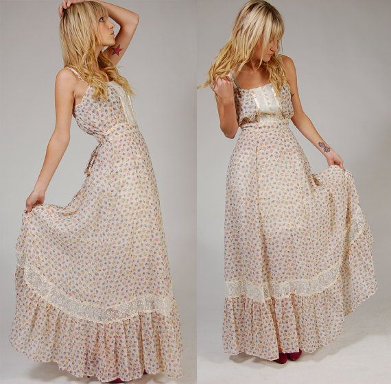 The ultimate boho chic maxi dress! Sweet and feminine long prairie dress with a lace and ribbon trimmed bodice, thin straps and an empire waist.