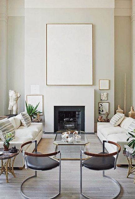Neutral Living Room With Pair Of White Sofas, Modern White Mantle Artwork  And Charles Hollis Jones Brass And Glass Coffee Table. Design By Daniel  Romualdez.
