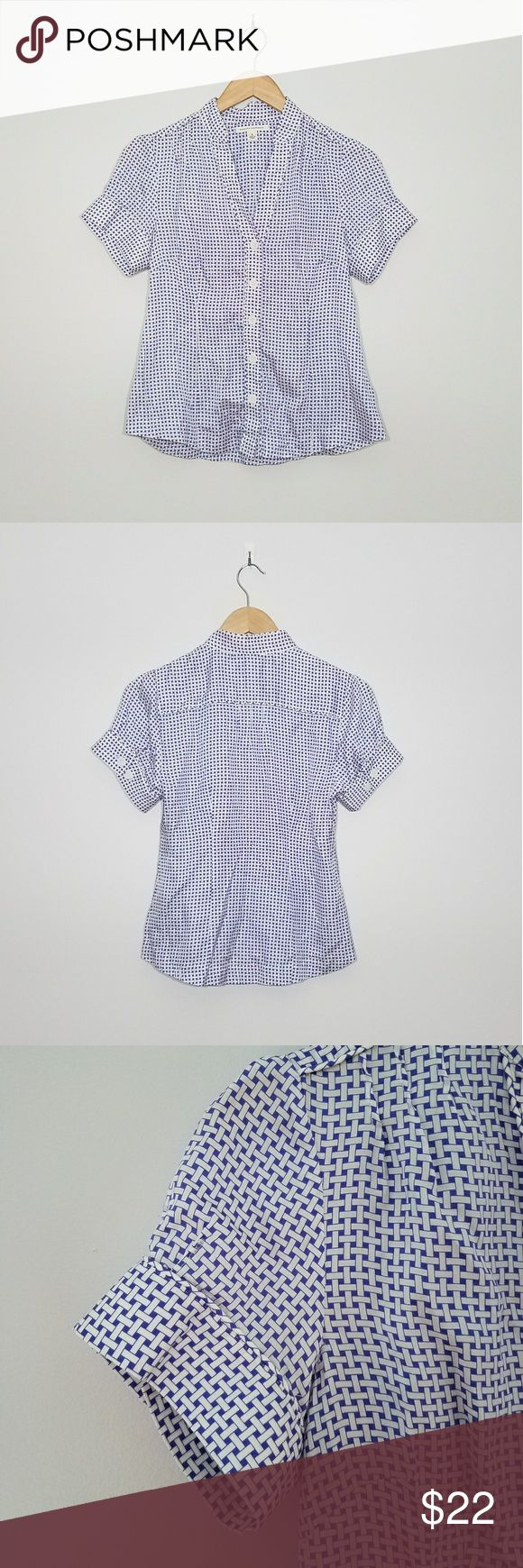 """Banana Republic white blue button down top Banana Republic short sleeved button down with white and blue basket weave design. V-neck. Large white buttons line the front and decorate the cuffed sleeves to add interest. Measurements are approx 36"""" bust, 23"""" length from top of shoulder to bottom hem. Excellent used condition. Banana Republic Tops Button Down Shirts"""