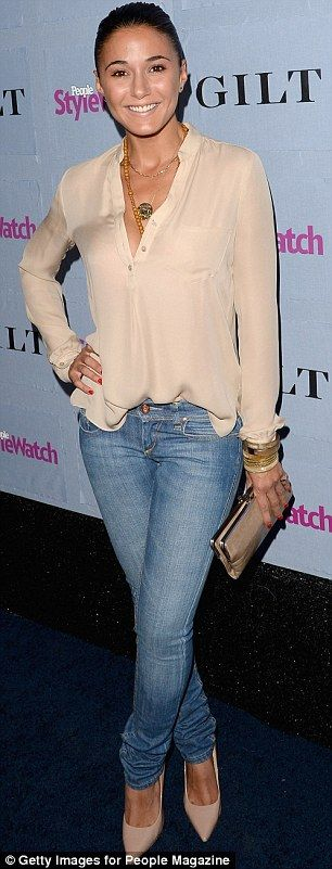 Emmanuelle Chriqui in jeans, a beige blouse and matching pumps